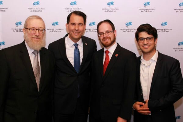 Agudath Israel staff with Wisconsin Governor Scott Walker at an American Federation for Children school choice discussion in Cleveland during the RNC. (L-R: Rabbi Labish Becker, Governor Scott Walker, Rabbi A. D. Motzen, Rabbi Yitz Frank)