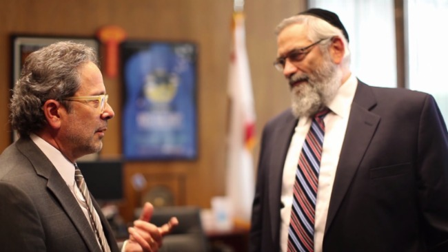 California Assemblymember Richard Bloom speaking with Agudath Israel of California Chairman Dr. Irving Lebovics