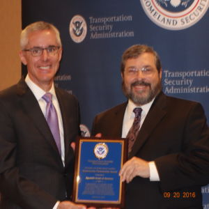 Rabbi Abba Cohen, Agudath Israel's Vice President for Federal Affairs and Washington Director (R), stands with TSA Administrator Peter V. Neffenger as he accepts the 2016 Community Partnership Award on behalf of Agudath Israel of America at the 14th Annual TSA Coalition Conference.
