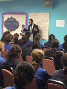 Agudath Israel's Mid-Atlantic regional director, Rabbi Ariel Sadwin, sharing his perspective on the presidential race and the election process with Bnos Yisroel high school students in Baltimore