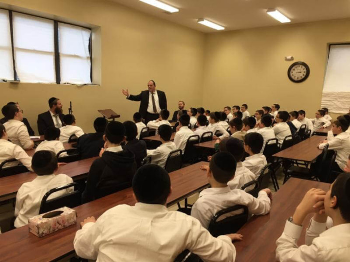 Agudath Israel's New Jersey director, Rabbi Avi Schnall, speaking to students of Yeshivas Sha'agas Aryeh about the history of Agudath Israel of America and the importance of helping the larger community.