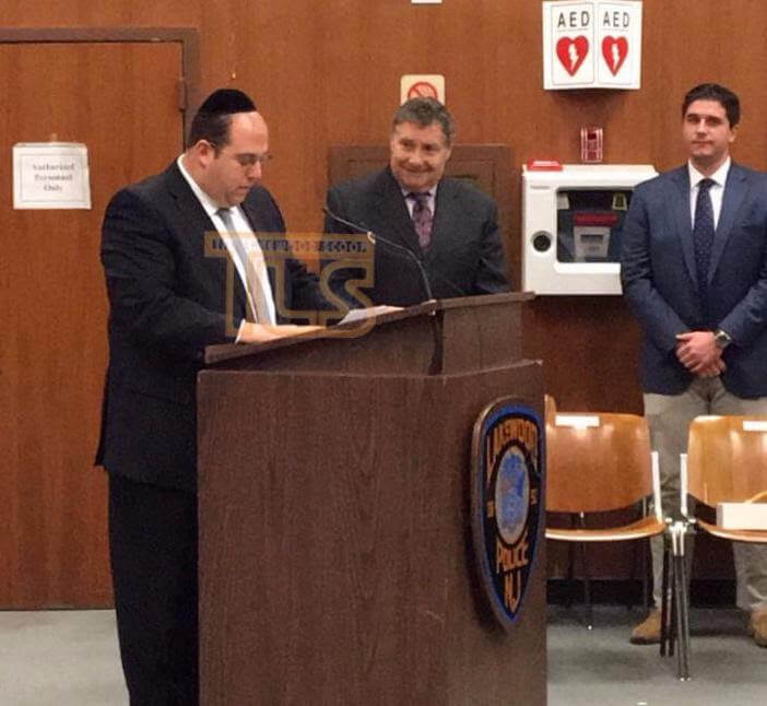 Rabbi Avi Schnall delivering the invocation at reorganization day in Lakewood Township, NJ