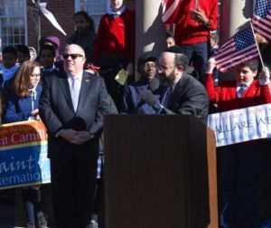 Rabbi Ariel Sadwin introducing Maryland Governor Larry Hogan at a recent rally in Annapolis